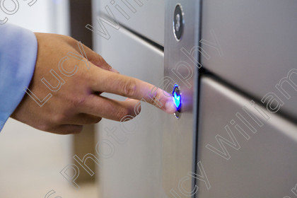 lift colour   Male city worker's finger pressing the down button on the elevator   Keywords: male, the city, city worker, corporate, London, Britain, UK, finger, hand, button, blue, arrow, down, going down, lift, elevator, credit crunch, recession, depression, colour, color, horizontal